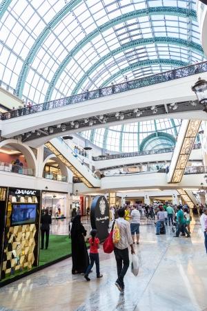 DUBAI, UAE - APRIL 29: Shoppers at Mall of the Emirates on April 29, 2013 in Dubai. Mall of the Emirates is a shopping mall in the Al Barsha district of Dubai.