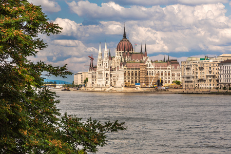 The building of the Hungarian Parliament in Budapest at the river Danube, Hungary photo