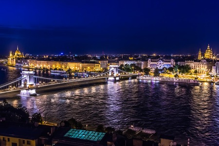 River view of Budapest at evening, illuminated Chain Bridge and Parliament Building. photo
