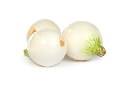 pealing: Group of a onions, isolated against white background Stock Photo