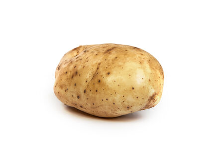 unwashed: One potato isolated on a white background Stock Photo