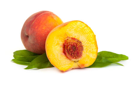 Three perfect, ripe peaches with a half  and slices isolated on a white background. photo