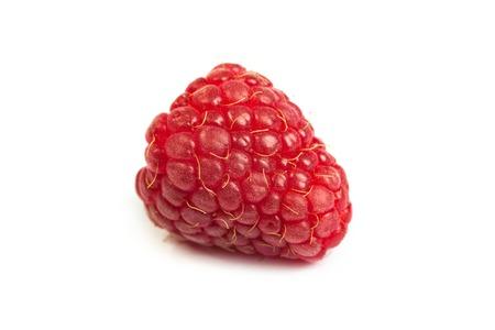 retouched: Single fresh sweet raspberry. Isolated over white background. Close up macro shot. Image was professionally retouched