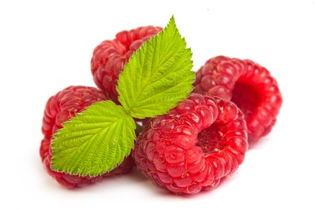 retouched: Bunch of a red raspberry on a white background. Close up macro shot. Image was professionally retouched