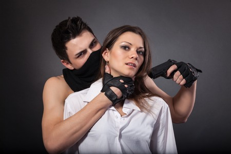 male killer: Man take a beautiful woman as a hostage isolated on a white background Stock Photo