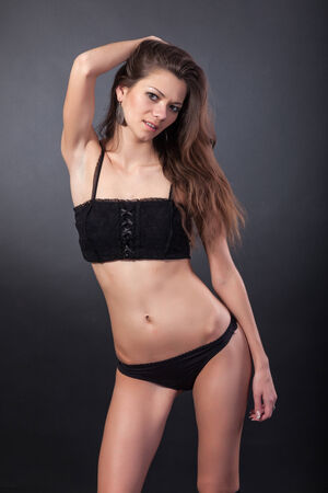 Sexy woman body. Erotic underwear isolated on a black background photo