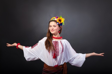 bead embroidery: Attractive woman wears Ukrainian national dress isolated on a black background Stock Photo