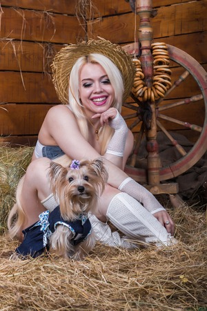 Young sexy girl in underwear and white boots sit in the barn with hay photo