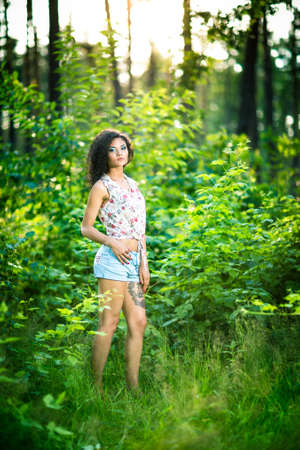 portrait of pretty cute beautiful woman in a park  on a warm summer day photo
