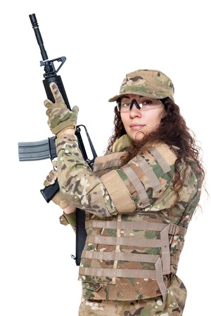 Beautiful army girl with rifle isolated on white photo