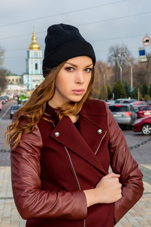 young beautiful woman posing outdoors. stylish fashion portrait photo