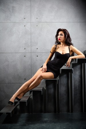 sexy woman lying on stairs at backyard of building photo