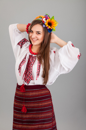 Attractive woman wears Ukrainian national dress isolated on a black background Stock Photo