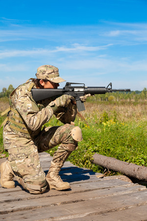 Soldier with a rifle in the field