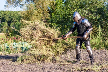 roundtable: Medieval knight in the field with a pitchfork