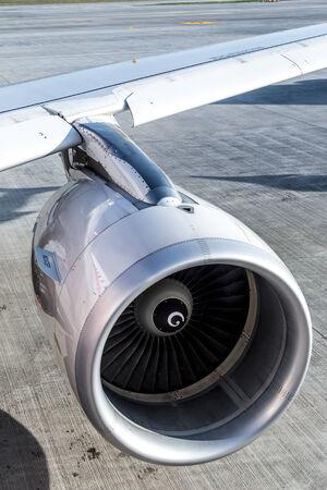 engine of passenger airplane waiting in airport photo