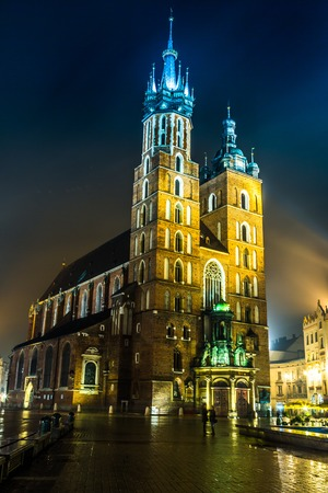 Krakow old city at night St. Marys Church at night. Krakow Poland. photo