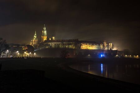 Krakow old city at night. Wawel Castle and Wistula. Krakow? Poland. photo
