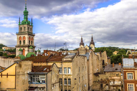 The high tower of The Assumption church among old roofs, Lviv, Ukraine. Stock Photo