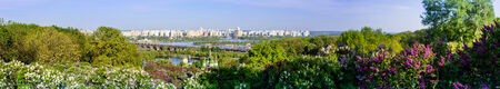 Panorama of the city of Kiev. Ukraine. View of the monastery Vydubitsky, left bank of the Dnieper River and the modern part of town. Kyiv. photo