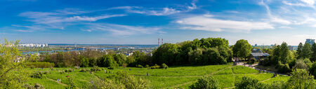 panorama of city landscape and nature. Kiev, Ukraine. Green trees, architecture, and blue river photo