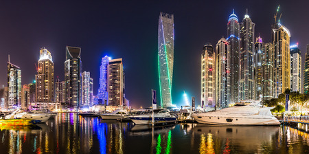 DUBAI, UAE - NOVEMBER 13: Dubai downtown night scene with city lights, luxury new high tech town in middle East. Dubai Marina cityscape,  on November 13, 2012 in Dubai, UAE.