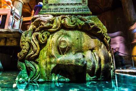 ISTANBUL - AUGUST 8: Medusa head in the Basilica Cistern, August 8, 2013 in Istanbul, Turkey. It is 143m long and 65m wide underground water container, the one of most popular tourist attraction.