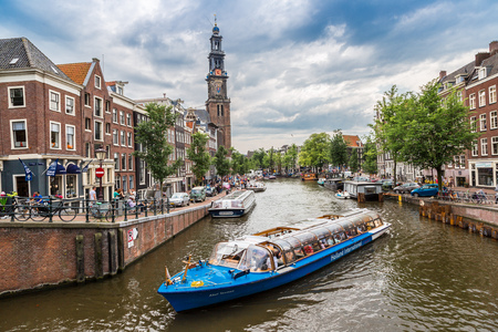 westerkerk: AMSTERDAM, NETHERLANDS - AUGUST 19: Westerkerk in Amsterdam. Amsterdam is the capital and most populous city of the Netherlands on August 19, 2014 Editorial