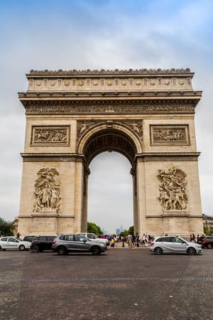 triumphe: PARIS, FRANCE - JULY 14 2014: The Arc de Triomphe de lEtoile is one of the most famous monuments in Paris, July 14, 2014
