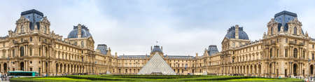 louvre pyramid: PARIS, FRANCE - JULY 14 2014: The Louvre is one of the worlds largest museums and a historic monument in Paris, July 14, 2014