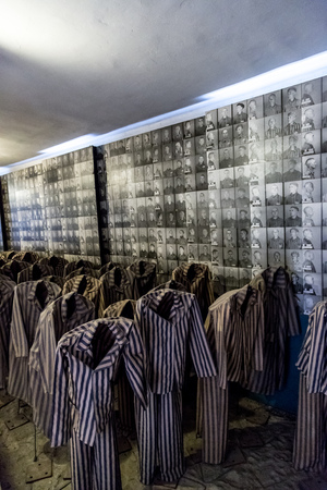 prisoners: OSWIECIM, POLAND - JULY 22: Exhibition with prisoners clothes in Auschwitz. It is the biggest nazi concentration camp in Europe on July 22, 2014 in Oswiecim, Poland Editorial