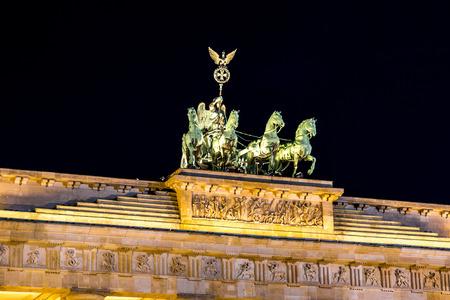 road side: Brandenburg gate, Berlin, Germany at night. Road side view