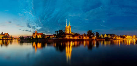 A cityscape cathedral, river Odra. Wroclaw, Poland, at dusk. Panorama. photo