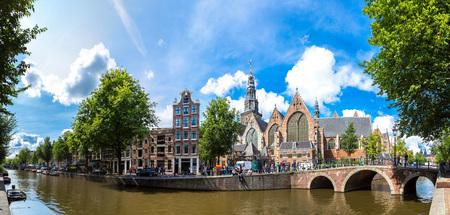 amsterdam: Oude Kerk (Old Church) and Voorburgwal canal in Amsterdam