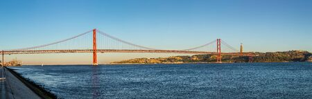 the tagus: Rail bridge  over the Tagus river  in Lisbon, Portugal. Stock Photo