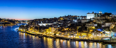 portugal: Panoramic view of Porto and the Dom Luiz bridge in Portugal at night Stock Photo