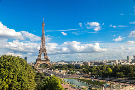 aerial: Aerial view of the Eiffel Tower in Paris, France in a beautiful summer day