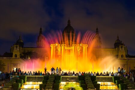 montjuic: Magic Fountain light show at night next to National museum in Barcelona, Spain
