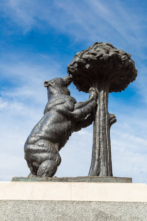 strawberry tree: Statue of bear and strawberry tree, it is a symbol of Madrid, Spain