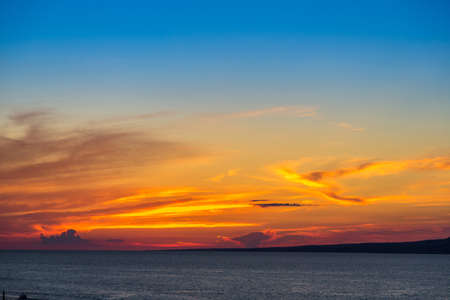 View of a  beautiful sunset above the sea photo