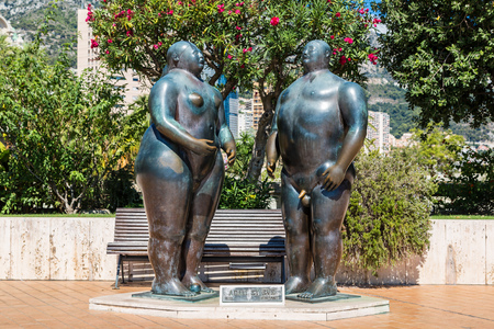adam and eve: MONTE CARLO - JULY 17: Sculpture of Adam and Eve by Fernando Botero in garden Monte Carlo in Monaco in a summer day on July 17, 2014