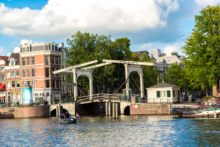 populous: Canal and bridge in Amsterdam. Amsterdam is the capital and most populous city of the Netherlands Editorial
