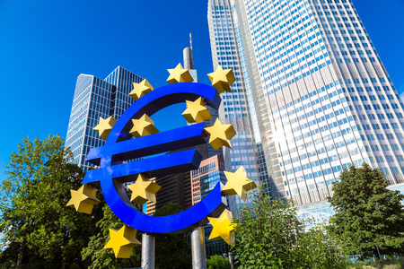 the central bank: Euro sign. European Central Bank headquarters in Frankfurt in Germany  in summer day