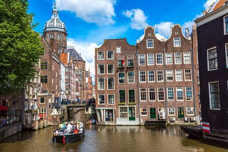 st nicholas cathedral: Canal and St. Nicolas Church in Amsterdam. Amsterdam is the capital and most populous city of the Netherlands Stock Photo