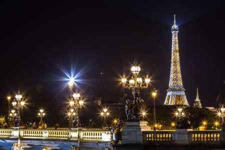 alexandre: PARIS, FRANCE - JULY 14 2014: The Eiffel Tower and Pont Alexandre III at night in Paris, France, July 14, 2014