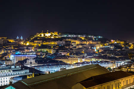 jorge: Aerial view of Lisbon at night, Portugal. Sao Jorge Castle