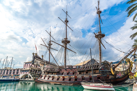 pirate flag: Galeone old wooden ship in a summer day in Genoa, Italy Stock Photo