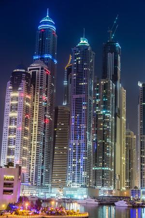 DUBAI, UAE - NOVEMBER 13: Dubai downtown night scene with city lights, luxury new high tech town in middle East. Dubai Marina cityscape,  on November 13, 2012 in Dubai, UAE.