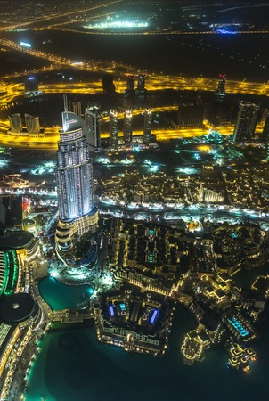 lavish: DUBAI, UAE - NOVEMBER 13: Address Hotel and Lake Burj Dubai in Dubai. The hotel is 63 stories high and feature 196 lavish rooms and 626 serviced residences, taken on 13 November 2012 in Dubai. Editorial