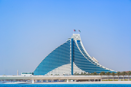 preceded: DUBAI, UAE - FEBRUARY 03: Jumeirah Beach Hotel, preceded by the luxury marina, on February 3, 2013. Wave-shaped resort, next to famous Burj Al Arab, remains one of the well-known landmarks of Dubai, UAE. Editorial